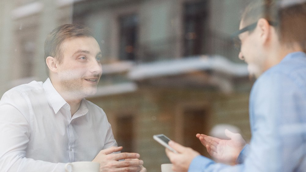 portrait of two excited friends meeting in cafe and chatting cheerfully linkedin facebook twitter email learn how to network more effectively