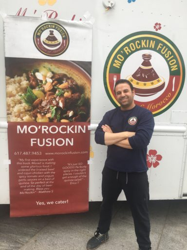 Man standing by food truck - Mo'Rockin Fusion