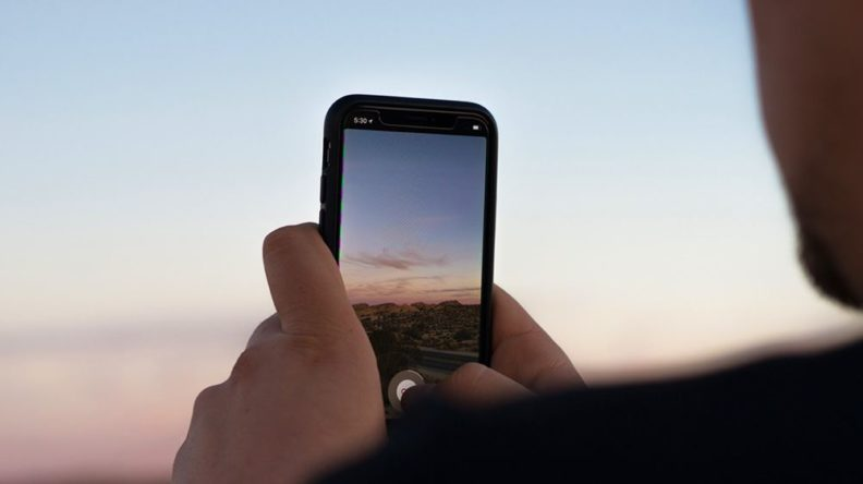 Man taking an Instagram picture on his phone
