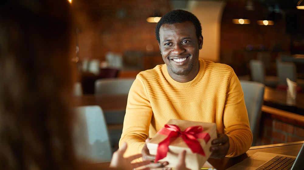 Man receiving wrapped present