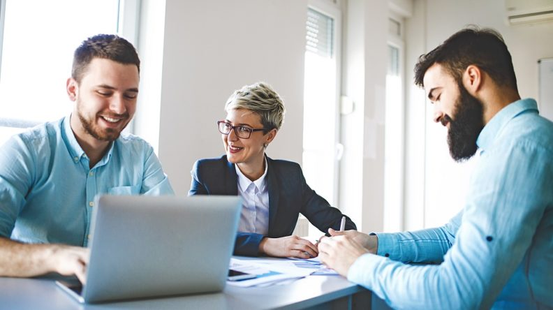 Three people enjoying a work conversation