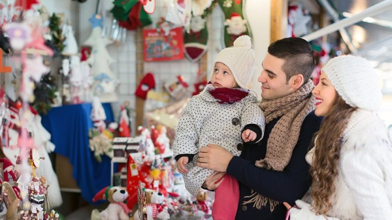 family with young child doing holiday shopping