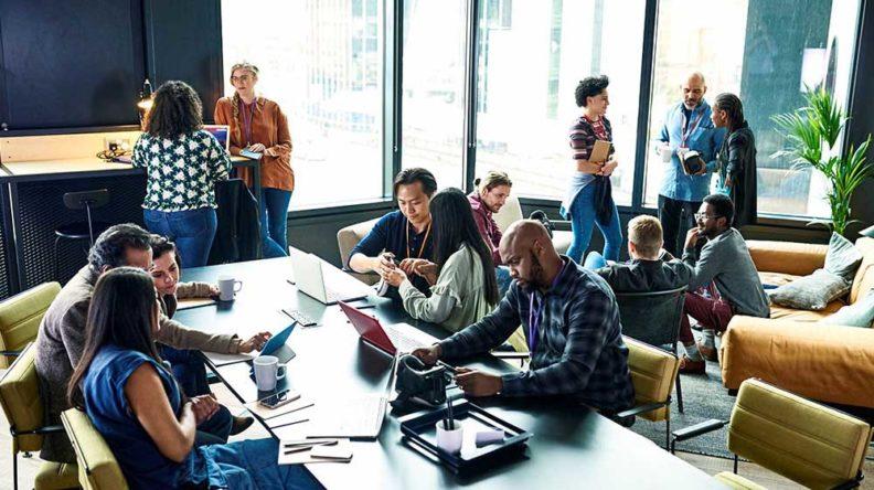 People working around a desk
